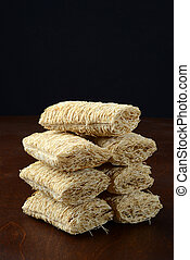 closeup stack of shredded wheat cereal