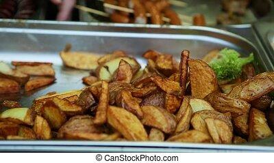 closeup street food fried potato - closeup panorama homemade...