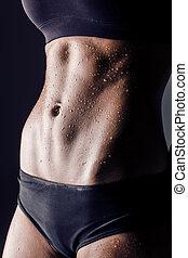 closeup studio shot fitness woman abs