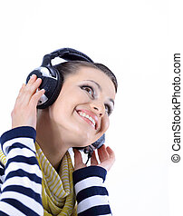 closeup. stylish girl listening to music with headphones