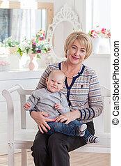 Closeup summer portrait of happy grandmother with grandchildren