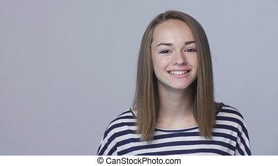 Closeup teen girl smiling gesturing thumb up - Closeup...