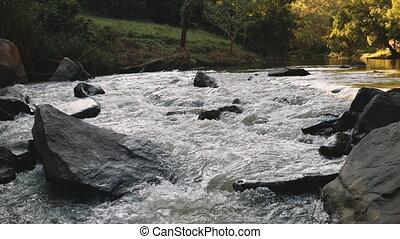 Closeup Thai landscape: river water thresholds in jungle, ...