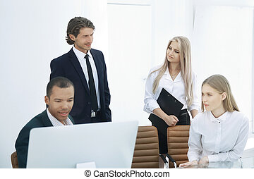 closeup. the employees are talking in a modern office.