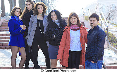 group of students standing on the street