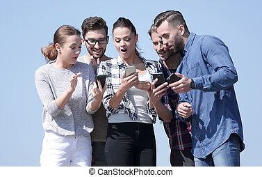 closeup. the group of students using smartphones. isolated ...