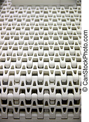 Patterns of white plastic with a conveyor belt. - Closeup ...