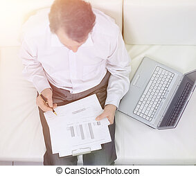 view from the top. businessman working with documents sitting on