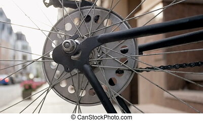 Closeup toned footage of spinning wheel of old bicycle -...