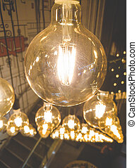 Closeup toned image of beautiful decorative incandescent light bulbs glowing