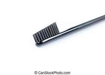 Closeup toothbrush. For men. Full black brush. Isolated on a white background.