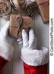 Santa holding a plain wrapped Christmas gift