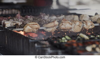 Closeup. Traditional shish kebab. Fried pork on the grill. Delicious grilled meat. Barbecue