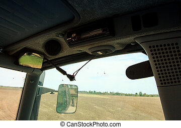 closeup upper panel in tractor cabin with backview mirror