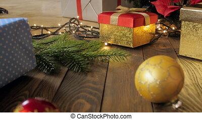 Closeup video of camera slowly moving towards Christmas tree...
