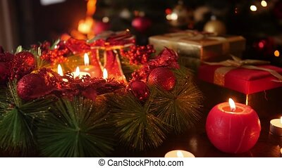 Closeup video of Christmas wreath with burning candles. Perfect background or backdrop for Christmas or New Year