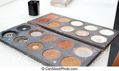 Closeup video of colorful palette with paints and shadows...