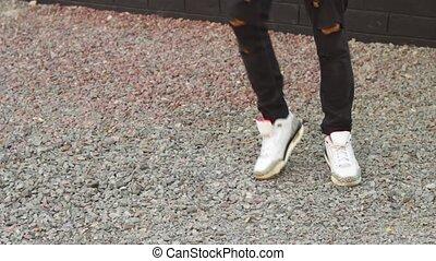 Closeup video of dancing legs of man outdoor