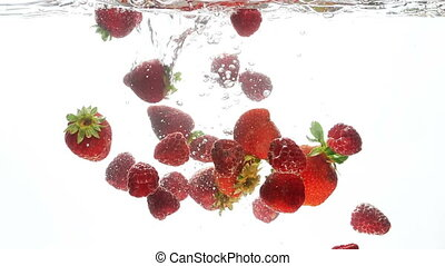 Closeup video of fresh ripe strawberries and raspberries...