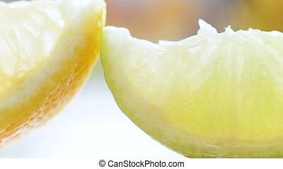 Closeup video of lemon, lime and orange slices on white...