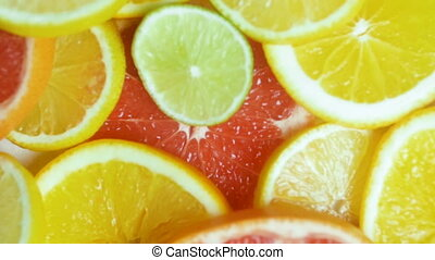 Closeup video of slices of citrus fruits lying on table