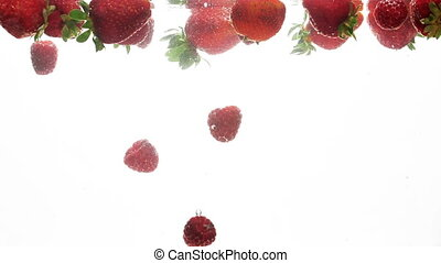 Closeup video of strawberries and raspberries slowly...