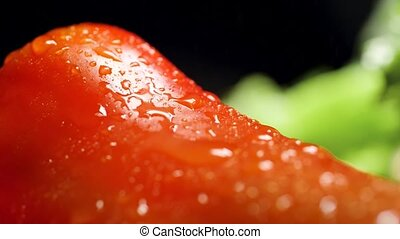 Closeup video of water droplets slowly falling on red ...