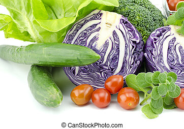 closeup view assorted vegetable. purple cabbage, cherry tomatoes, mint, salad and zucchini isolated white background