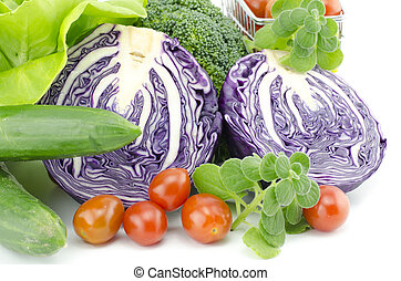 closeup view healthy vegetable. purple cabbage, cherry tomatoes, mint, salad and zucchini isolated white background