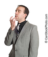 Closeup view of a businessman tapping his chin as a step in performing the Emotional Freedom Technique, isolated against a white background