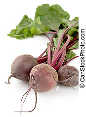 Closeup view of chard with three beetroots on white background