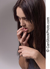 closeup view of doped female looking away. addicted and...