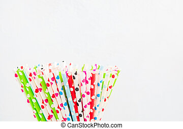 Closeup view of ecologycal paper straw with hearts on white ...
