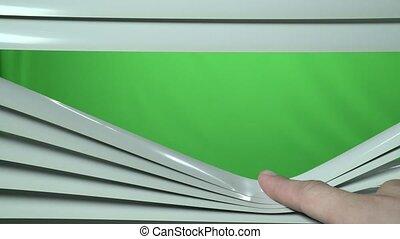 Closeup view of human finger open jalousie. Green screen -...