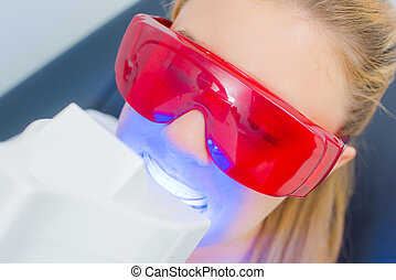 Closeup view of lady having dental treatment