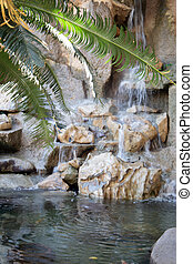 Closeup view of little waterfall on the river current in the...