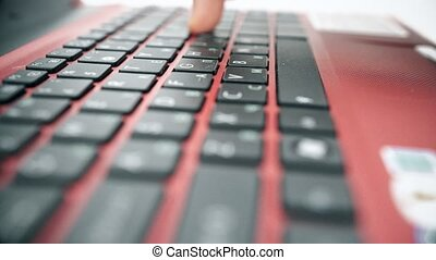 Closeup view of man's hands typing on the laptop's keyboard....