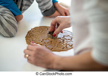 Closeup view of mother and child making cookies
