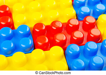 Closeup view of plastic building blocks. Colorful background