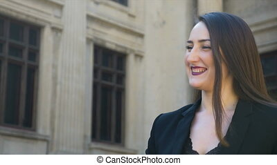 Closeup view of young happy girl talking and laughing in the city
