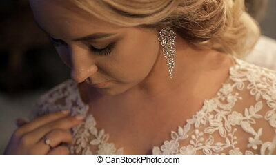 Closeup view on face and neck of bride waiting for begin of wedding.