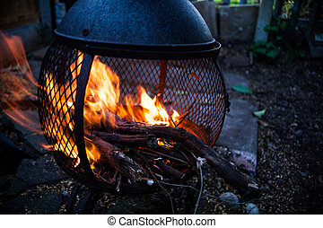 Closeup view on open fire flames. Burning bonfire in the...