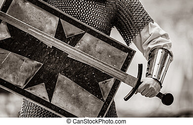 traditional medieval knight with shield and sword
