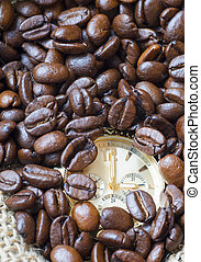 Closeup watch in the lots of natural coffee beans