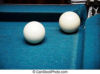 closeup white billiard balls near the pockets