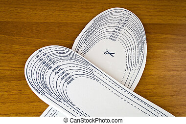 insoles - closeup white insoles with cut lines on wood ...