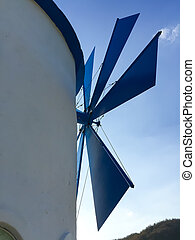 closeup white windmill against blue sky in the evening