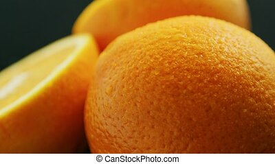 Closeup whole and cut orange - Macro shot of whole and...