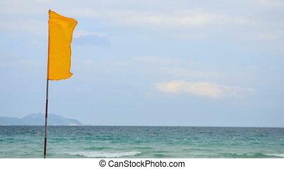 Closeup Wind Flaps Banner on Flagstaff on Sea - closeup wind...
