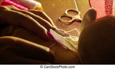 Closeup Woman Hands Sew Embroider Butterfly Wings at Table -...